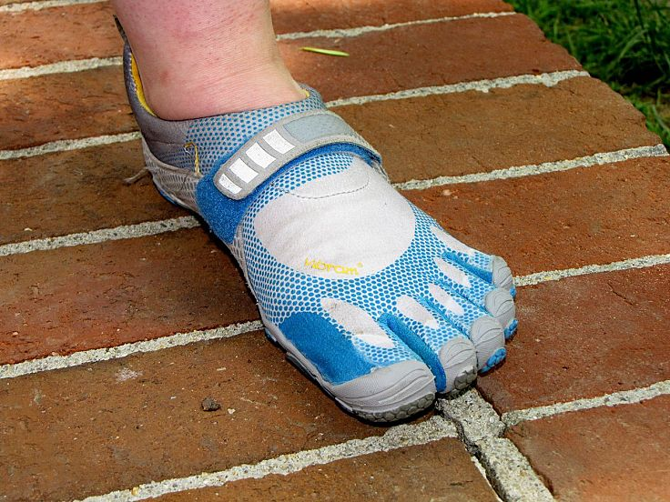 The minimalist barefoot Five Fingers shoe designed to protect from abrasion, but otherwise allow barefoot action
