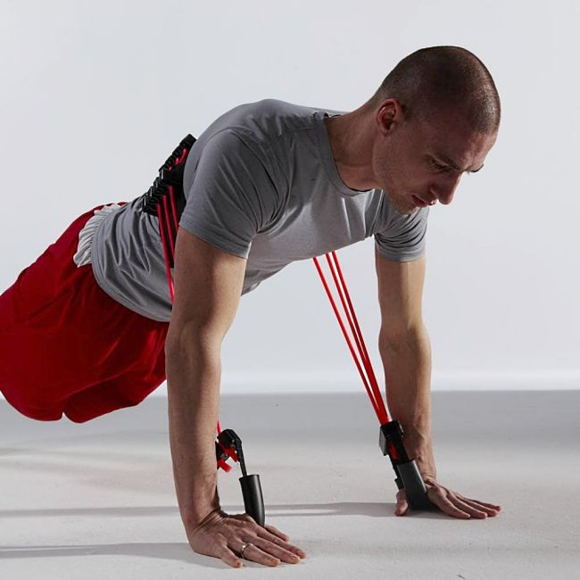 The work required for push ups can be easily increased using resistance bands without raising the legs higher.