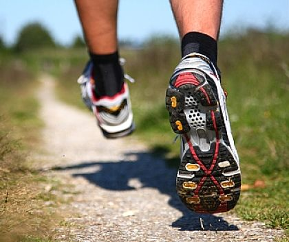 Good shoes are essential for running on hard surfaces, especially if its uneven.