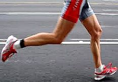 Athlete running on road with a clear 'heel-first' gait