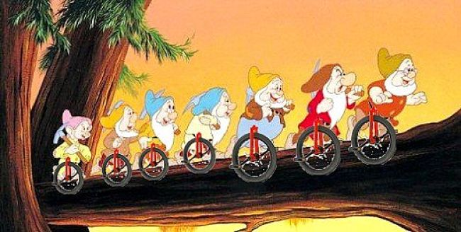 Pedal While Your Work - The Seven Dwarves writing unicycles
